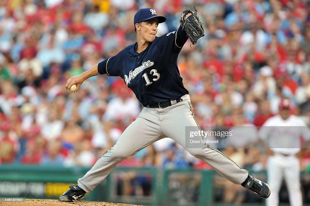 Starting pitcher <a gi-track='captionPersonalityLinkClicked' href=/galleries/search?phrase=Zack+Greinke&family=editorial&specificpeople=212804 ng-click='$event.stopPropagation()'>Zack Greinke</a> #13 of the Milwaukee Brewers delivers a pitch during the game against the Philadelphia Phillies at Citizens Bank Park on July 24, 2012 in Philadelphia, Pennsylvania.