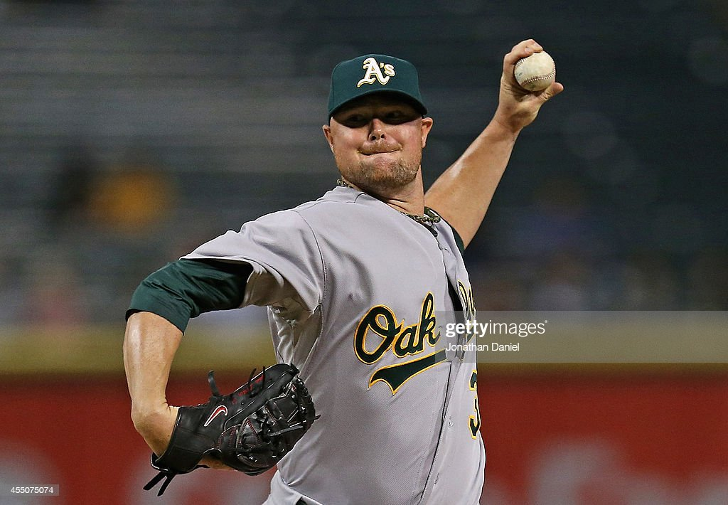 Starting pitcher<a gi-track='captionPersonalityLinkClicked' href=/galleries/search?phrase=Jon+Lester&family=editorial&specificpeople=832746 ng-click='$event.stopPropagation()'>Jon Lester</a> #31 of the Oakland Athletics delivers the ball against the Chicago White Sox at U.S. Cellular Field on September 9, 2014 in Chicago, Illinois.