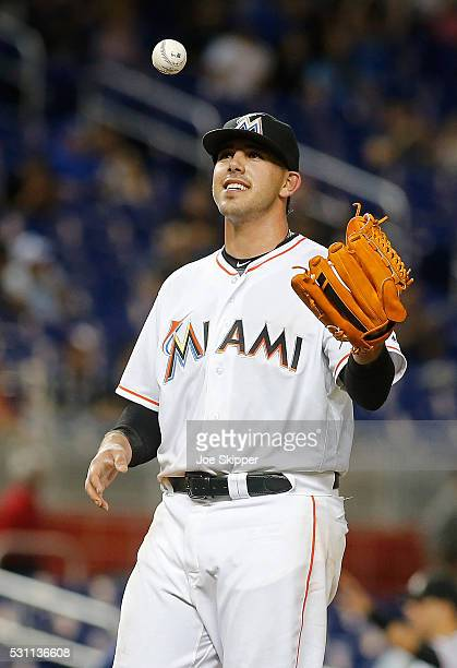 Starting pitcherJose Fernandez of the Miami Marlins pauses between pitches against the Milwaukee Brewers at Marlins Park on May 9 2016 in Miami...