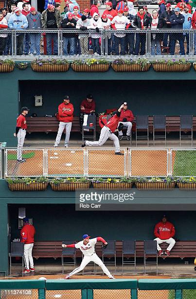 Starting pitchers Brett Myers of the Houston Astros and Roy Halladay of the Philadelphia Phillies warm up in the bullpen prior to the start of...