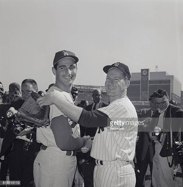 Starting pitchers Whitey Ford of the New York Yankees Sandy Koufax of the Los Angeles Dodgers shake hands before the fourth World Series game