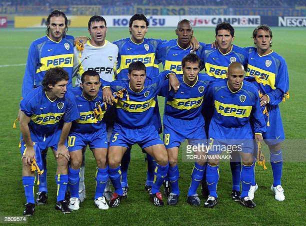 Starting players of Argentine football club Boca Juniors pose for photographers prior to kickoff the match against Italian football club AC Milan in...