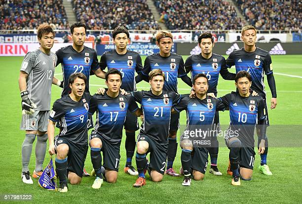 Starting players of Japan pose during a photo session prior to their 2018 World Cup qualifier Asian secondround Group E football match between Japan...