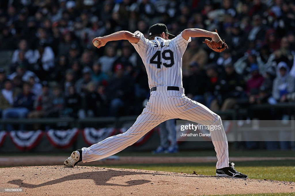 Starting pticher <a gi-track='captionPersonalityLinkClicked' href=/galleries/search?phrase=Chris+Sale&family=editorial&specificpeople=7132181 ng-click='$event.stopPropagation()'>Chris Sale</a> #49 of the Chicago White Sox delivers the ball against the Kansas City Royals during the Opening Day game at U.S. Cellular Field on April 1, 2013 in Chicago, Illinois. The White Sox defeated the Royals 1-0.