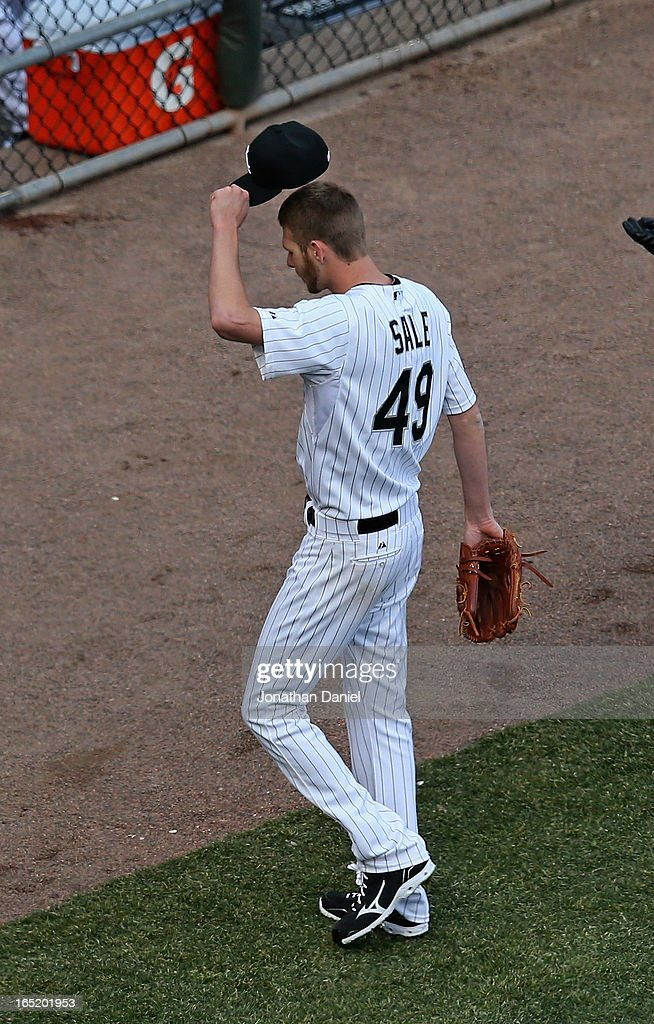 Starting pticher Chris Sale #49 of the Chicago White Sox tips his hat to the crowd after leaving the Opening Day game against the Kansas City Royals in the 8th inning at U.S. Cellular Field on April 1, 2013 in Chicago, Illinois. The White Sox defeated the Royals 1-0.