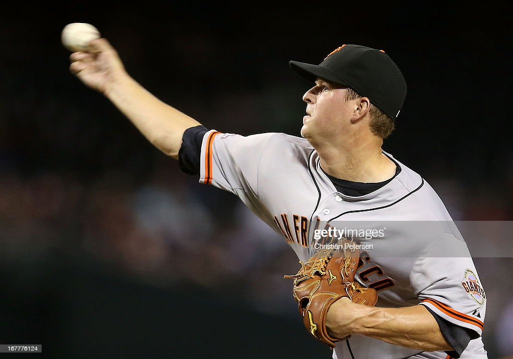 Starting pticher <a gi-track='captionPersonalityLinkClicked' href=/galleries/search?phrase=Matt+Cain&family=editorial&specificpeople=534602 ng-click='$event.stopPropagation()'>Matt Cain</a> #18 of the San Francisco Giants pitches against the Arizona Diamondbacks during the MLB game at Chase Field on April 29, 2013 in Phoenix, Arizona.
