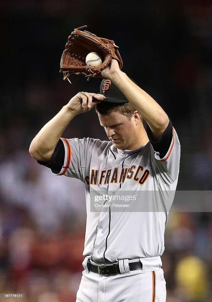 Starting pticher <a gi-track='captionPersonalityLinkClicked' href=/galleries/search?phrase=Matt+Cain&family=editorial&specificpeople=534602 ng-click='$event.stopPropagation()'>Matt Cain</a> #18 of the San Francisco Giants walks up to the mound to continue pitching against the Arizona Diamondbacks during the fourth inning of the MLB game at Chase Field on April 29, 2013 in Phoenix, Arizona.