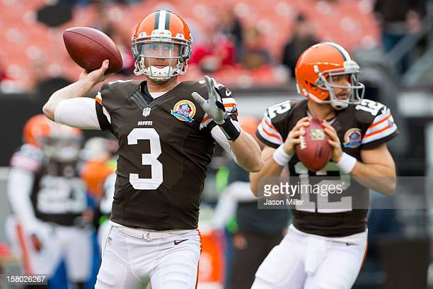 Starting quarterback Brandon Weeden and quarterback Colt McCoy of the Cleveland Browns warm up prior to the game against the Kansas City Chiefs at...