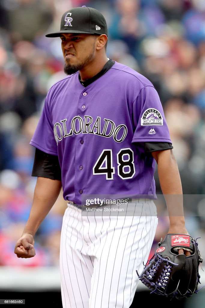 Startung pitcher German Marquez #48 of the Colorado Rockies celebrates as he walks to the dugout after the last out in the top of the eighth inning against the Chicagpo Cubs at Coors Field on May 10, 2017 in Denver, Colorado.