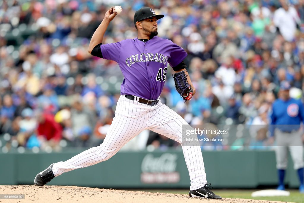 Startung pitcher German Marquez #48 of the Colorado Rockies throws in the fourtrh inning against the Chicagpo Cubs at Coors Field on May 10, 2017 in Denver, Colorado.
