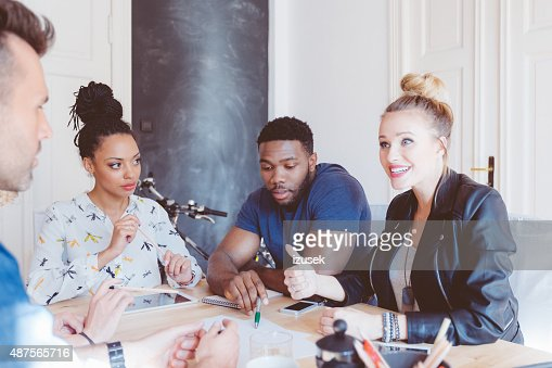 Start-up agency, multi ethnic team brainstorming