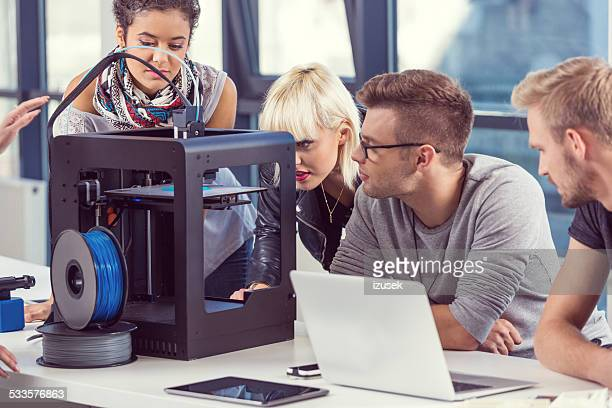 Start-up Business Team working by 3D printer