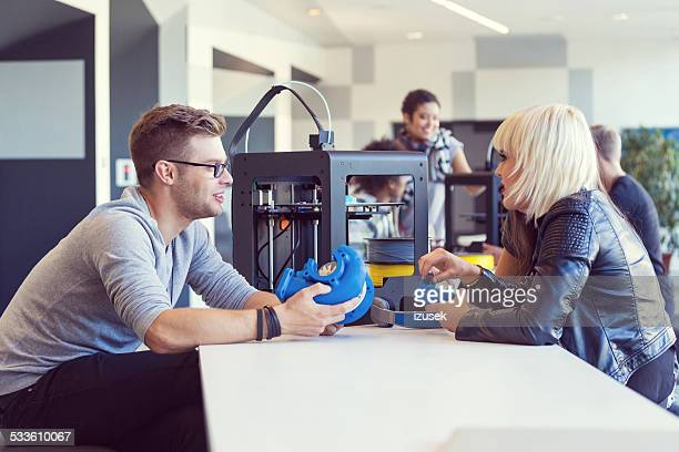Start-up Business Team working in 3D printer office