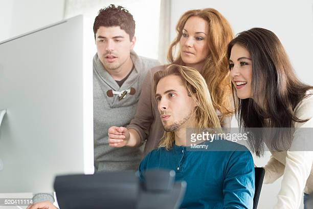 Startup company team checking new website