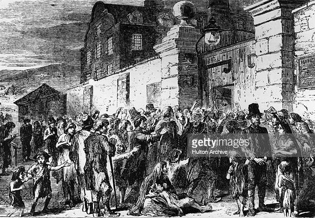 Starving peasants clamour at the gates of a workhouse during the Irish potato famine