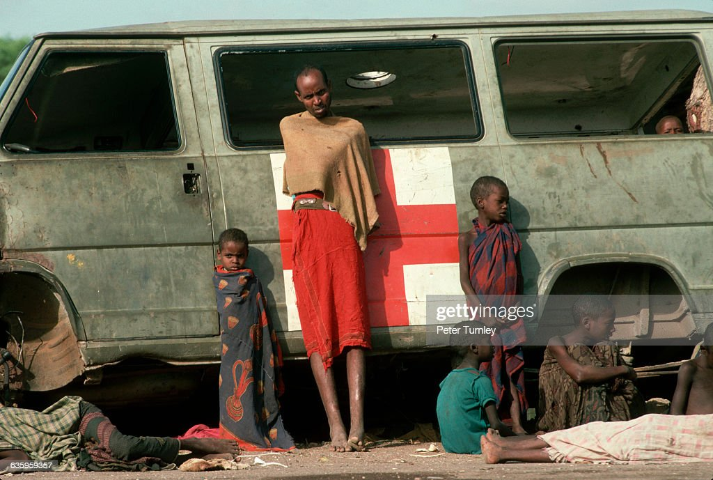 Starving Somalis lean against an abandoned American military medical vehicle during 'Operation Restore Hope' In the 1980s a civil war erupted in...