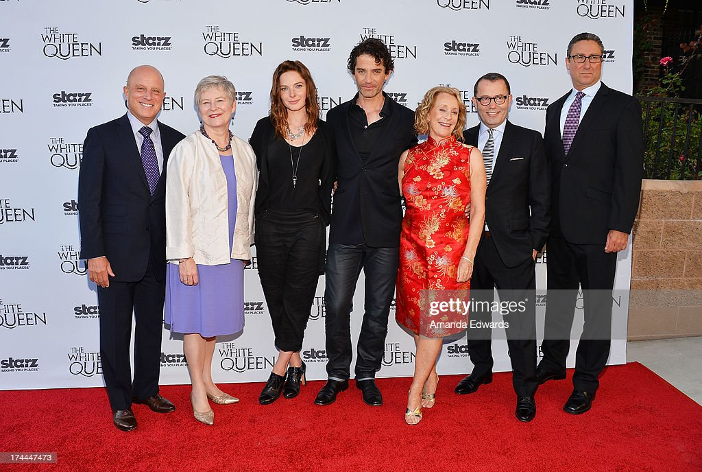 Starz CEO Chris Albrecht, Dame Barbara Hay, actress Rebecca Ferguson, actor James Frain, author Philippa Gregory, executive producer Colin Callender and Starz Originals Managing Director Carmi Zlotnik arrive at 'Cocktails with the Queen' - the British Consulate's toast to the U.S launch of the Starz original series 'The White Queen' at the British Consul General's Residence on July 25, 2013 in Los Angeles, California.