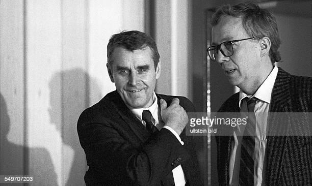 Stasi officer Manfred Schulz talking with journalist HansJuergen Boerner from the West German TV station ARD in Leipzig