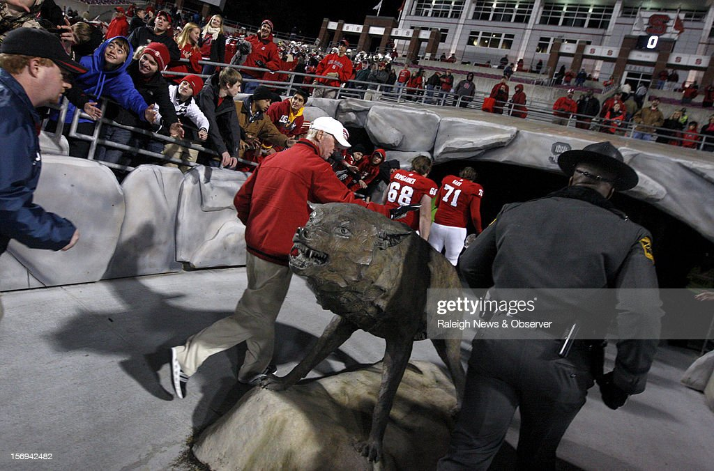N.C. State announced Sunday, November 25, 2012, that football head coach Tom O'Brien will not return for a seventh season after the Wolfpack completed a 7-5 regular season. Here, O'Brien pats the wolf statue after N.C. State's 27-10 victory over Boston College on November 24, 2012, at Carter-Finley Stadium in Raleigh, North Carolina. (Ethan Hyman/Raleigh News & Observer/MCT via Getty Images
