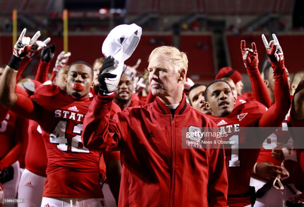 N.C. State announced Sunday, November 25, 2012, that football head coach Tom O'Brien will not return for a seventh season after the Wolfpack completed a 7-5 regular season. Here, O'Brien listens to the alma mater after the Wolfpack's 27-10 victory over Boston College ON November 24, 2012, in Raleigh, North Carolina.