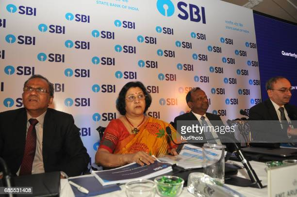 State Bank of India Chairman Mrs Arundhati Bhattacharya looks on as she announces the annual financial results of the bank for the year ended March...