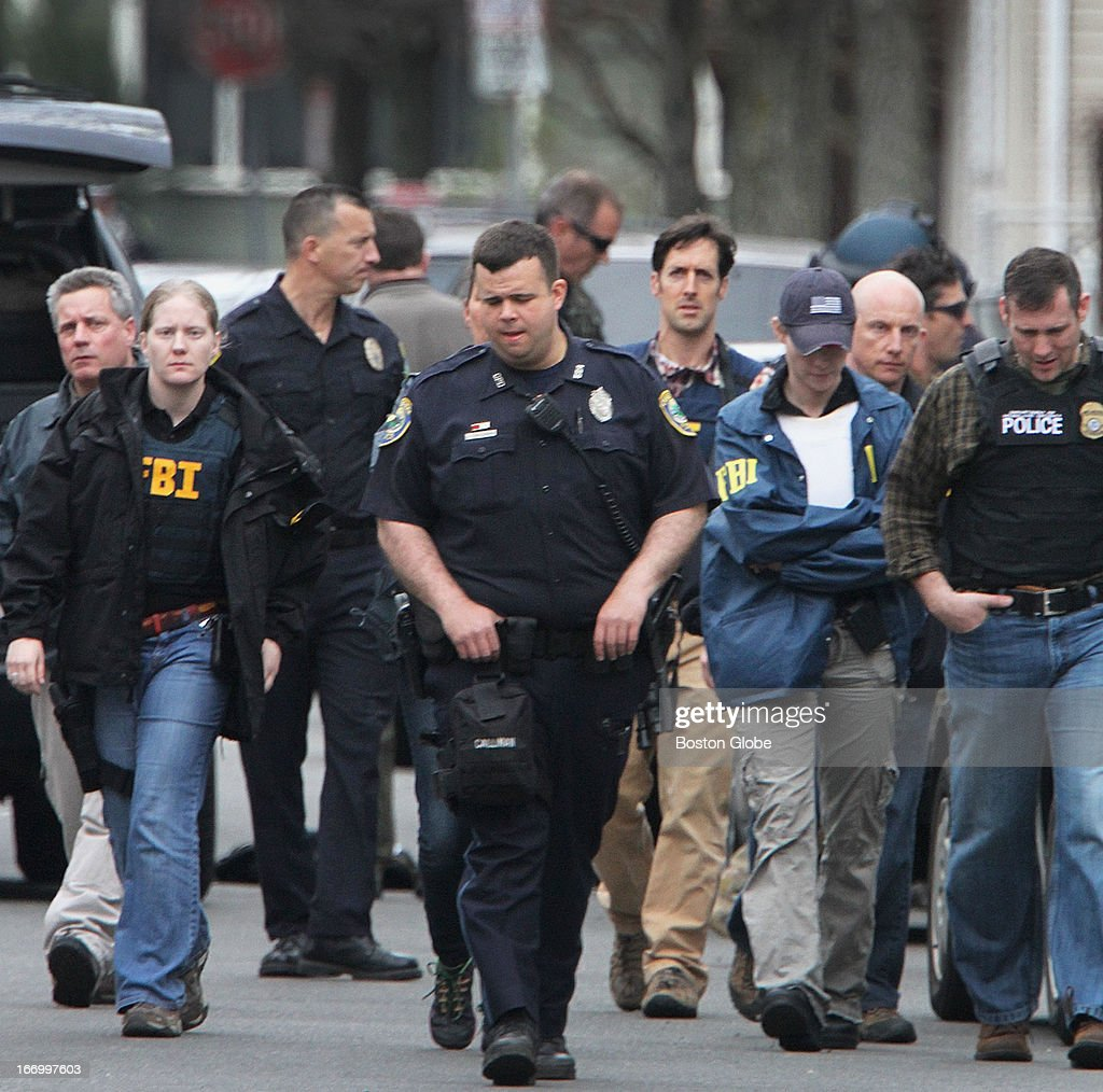 State, Cambridge and federal law officials surrounded several buildings on Norfolk Street in Cambridge, where the Tsarnaevs were believed to live, Friday, April 19, 2013. The Tsarnaev brothers are the suspects in the bombing of the 117th Boston Marathon and Dzhokhar A. Tsarnaev is the subject of an ongoing manhunt. His brother, Tamerlan, was pronounced dead after being injured in the chase last night.