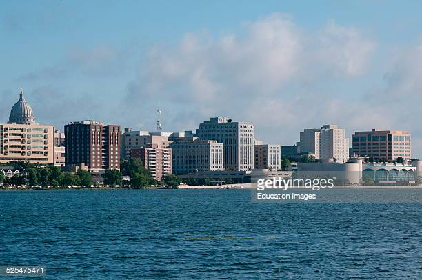 State capitol rises behind lakeside buildings Madison Wisconsin