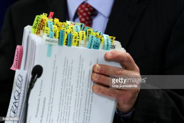 State Department acting spokesman Mark Toner's notebook is organized with reference tabs during the department's first oncamera briefing since...