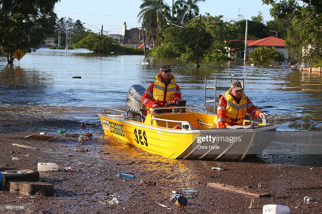 State Emergency Service patrol the streets on boat as parts of southern Queensland experiences record flooding in the wake of Tropical Cyclone Oswald on January 29, 2013 in Bundaberg, Australia.Four deaths have been confirmed and thousands have been evacuated in Bundaberg as the city faces it's worst flood disaster in history. Rescue and evacuation missions continue today as emergency services prepare to move patients from Bundaberg Hospital to Brisbane amid fears the hospital could lose power.