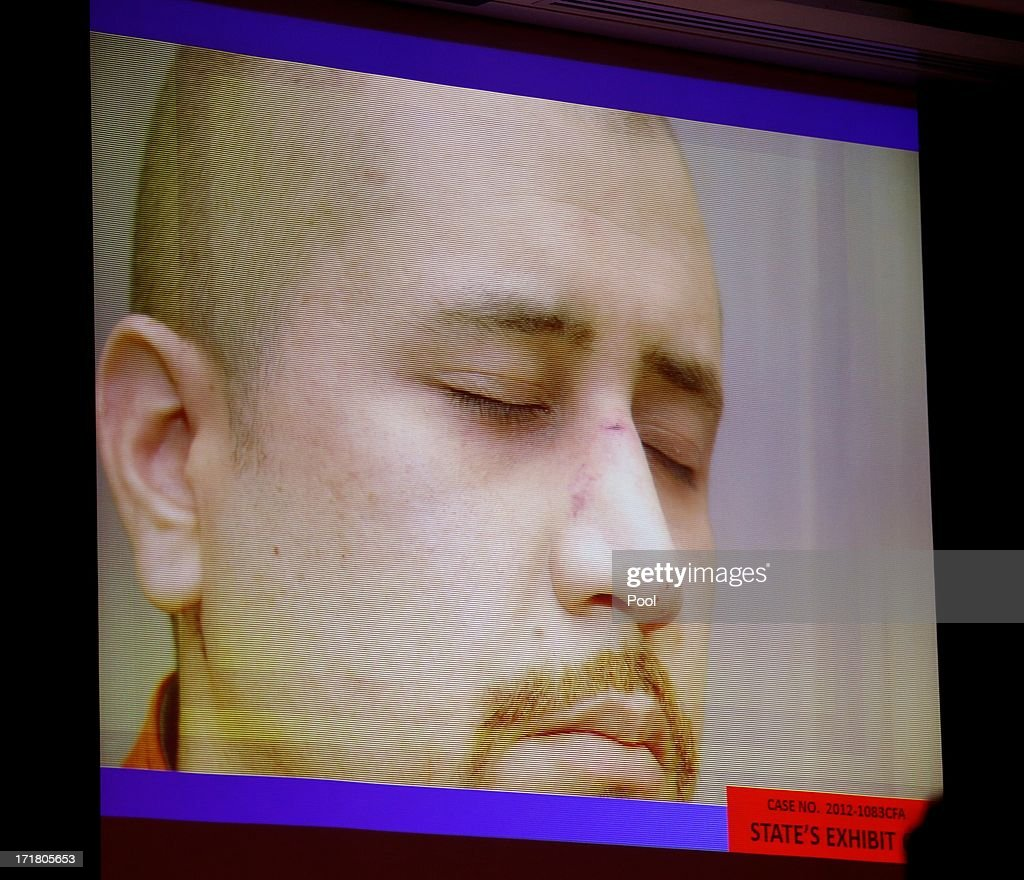 State exhibit photos, including this of George Zimmerman on the night of the Trayvon Martin shooting, are projected in court during the 15th day of Zimmerman's trial in Seminole circuit court June 28, 2013 in Sanford, Florida. Zimmerman is charged with second-degree murder for the February 2012 shooting death of 17-year-old Trayvon Martin.