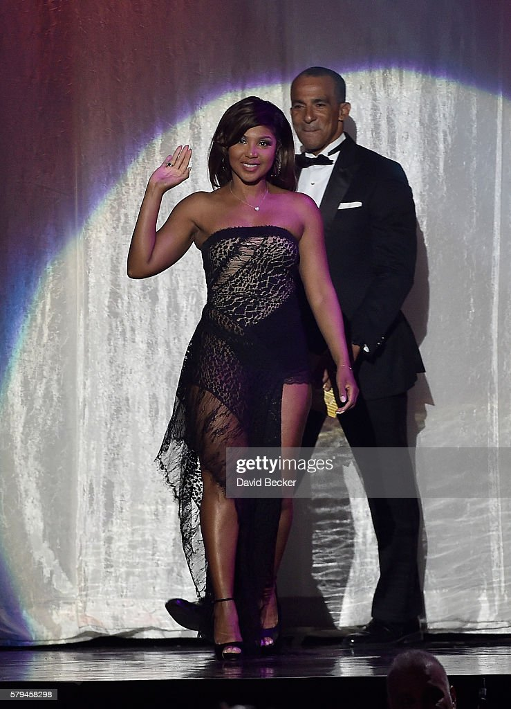 State Farm Mutual Automobile Insurance Company Executive VP and Chief Administrative Officer Duane Farrington (R) and singer Toni Braxton appear onstage during the 2016 Neighborhood Awards hosted by Steve Harvey at the Mandalay Bay Events Center on July 23, 2016 in Las Vegas, Nevada.