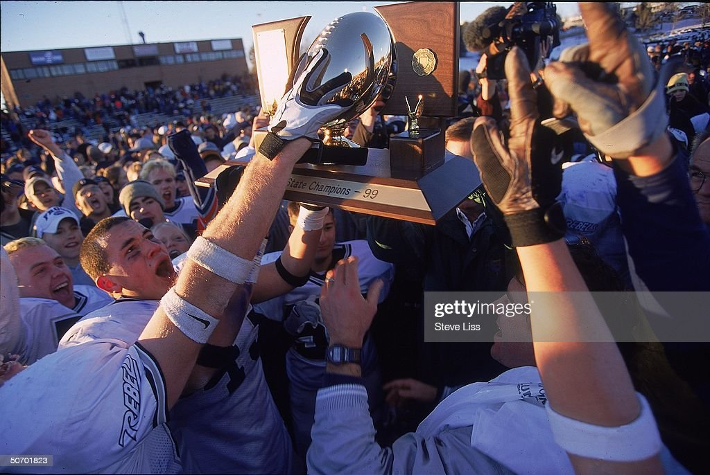 State football championship celebrated at Columbine High School in revival of school spirit despite scars left from last April's massacre by student...