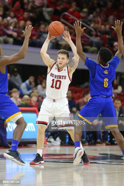 State guard Braxton Beverly looks to pass the ball during the game between the North Carolina State Wolfpack and the UMKC Kangaroos on December 9...