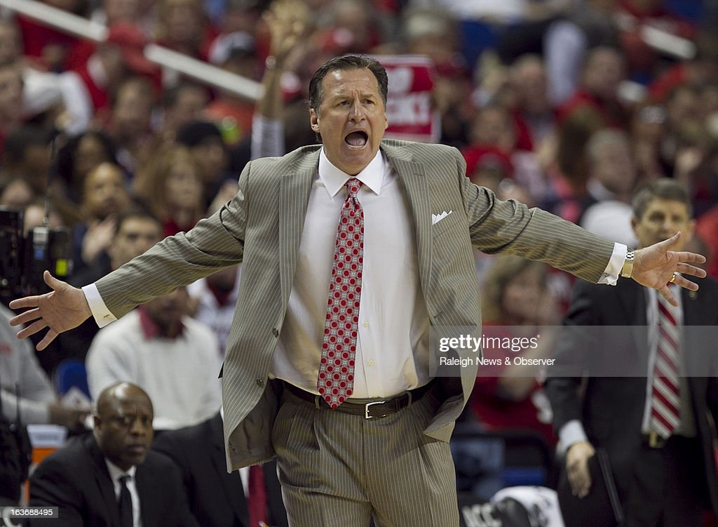 N.C. State head coach Mark Gottfried directs his team on defense during the second half in a men's ACC basketball tournament game against Virginia Tech at the Greensboro Coliseum in Greensboro, North Carolina, Thursday, March 14, 2013.