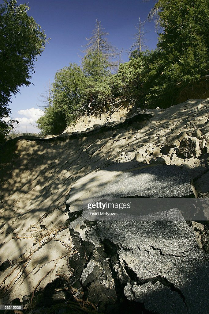 State Highway 173, one of only three major evacuation routes out of the area, remains unrepaired after part of it was washed down this steep mountainside during last winter's record rains, on August 1, 2005 near Lake Arrowhead, California. Last winter was one of the wettest on record, dropping 90 inches of rain in some southern California mountain areas and creating the thickest vegetation growth in memory, and damaging more than 2,000 miles of fire access roads used to protect 2.3 million acres of forests. In addition to the many thousands of trees killed by a massive pine beetle infestation, newly grown vegetation is drying up under triple-digit temperatures and raising fears of a repeat of the devastating fire season of 2003. President Bush signed an emergency funding bill in May allocating $25 million to fix roads in southern California?s national forests but Congress has acted slower than expected in providing the money so some of the repairs might not be done until October.