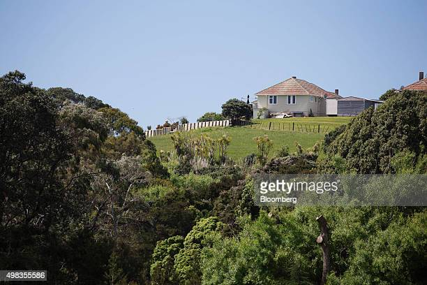 A state house stands on a hillin the suburb of Orakei in Auckland New Zealand on Friday Nov 13 2015 State homes particularly those built from local...