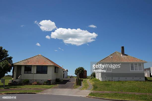 State houses stand in the suburb of Orakei in Auckland New Zealand on Friday Nov 13 2015 State homes particularly those built from local timber in a...