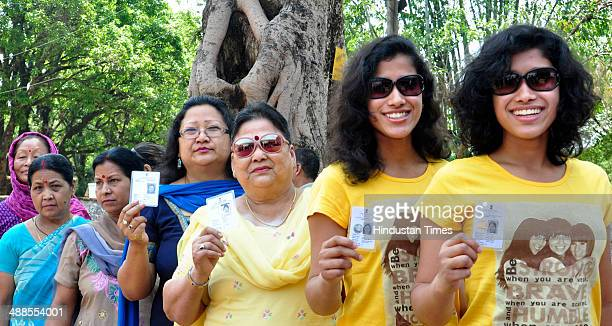 State icons Tashi Nungshi Malik wait in line before casting their first vote for 8th phase of Lok Sabha election on May 7 2014 in Dehradun India...