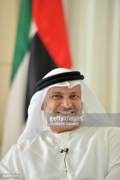 UAE state minister for foreign affairs Anwar Gargash poses for a picture during an interview with AFP in his office in Dubai on June 7 2017 / AFP...