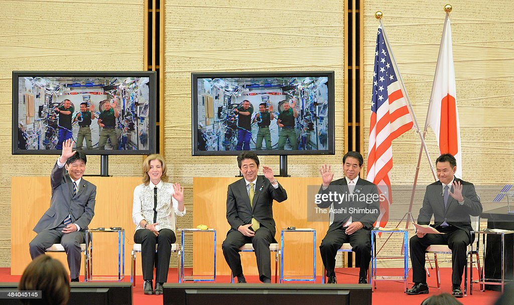 State Minister Ichita Yamamoto, U.S. Ambassador to Japan <a gi-track='captionPersonalityLinkClicked' href=/galleries/search?phrase=Caroline+Kennedy&family=editorial&specificpeople=93208 ng-click='$event.stopPropagation()'>Caroline Kennedy</a>, Japanese Prime Minister <a gi-track='captionPersonalityLinkClicked' href=/galleries/search?phrase=Shinzo+Abe&family=editorial&specificpeople=559017 ng-click='$event.stopPropagation()'>Shinzo Abe</a>; Education Minister <a gi-track='captionPersonalityLinkClicked' href=/galleries/search?phrase=Hakubun+Shimomura&family=editorial&specificpeople=4319928 ng-click='$event.stopPropagation()'>Hakubun Shimomura</a> and astronaut <a gi-track='captionPersonalityLinkClicked' href=/galleries/search?phrase=Akihiko+Hoshide&family=editorial&specificpeople=5329772 ng-click='$event.stopPropagation()'>Akihiko Hoshide</a> speak with astronauts of International Space Station (ISS) at Abe's official residence on April 10, 2014 in Tokyo, Japan.