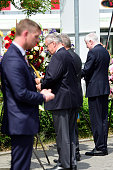 State Minister of Bavaria Horst Seehofer attends a wreathlying ceremony outside the OEZ shopping center the day after a shooting spree left nine...