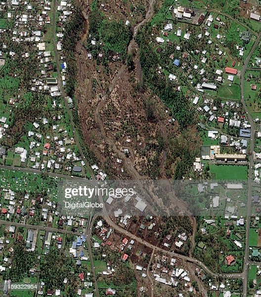 A state of emergency was declared in Samoa after Category 3 Cyclone Evan—the region's strongest storm in 20 years—tore through the islands on December 13, 2012. This image shows where a massive mudslide flowed down the hillside and destroyed homes and buildings in the capital city of Apia, located on the Island of Upolu.