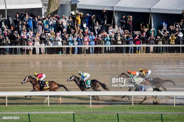 State of Honor ridden by Jose Lezcano leads the pack after the first turn in the 143rd Kentucky Derby on May 06 2017 at Churchill Downs in Louisville...