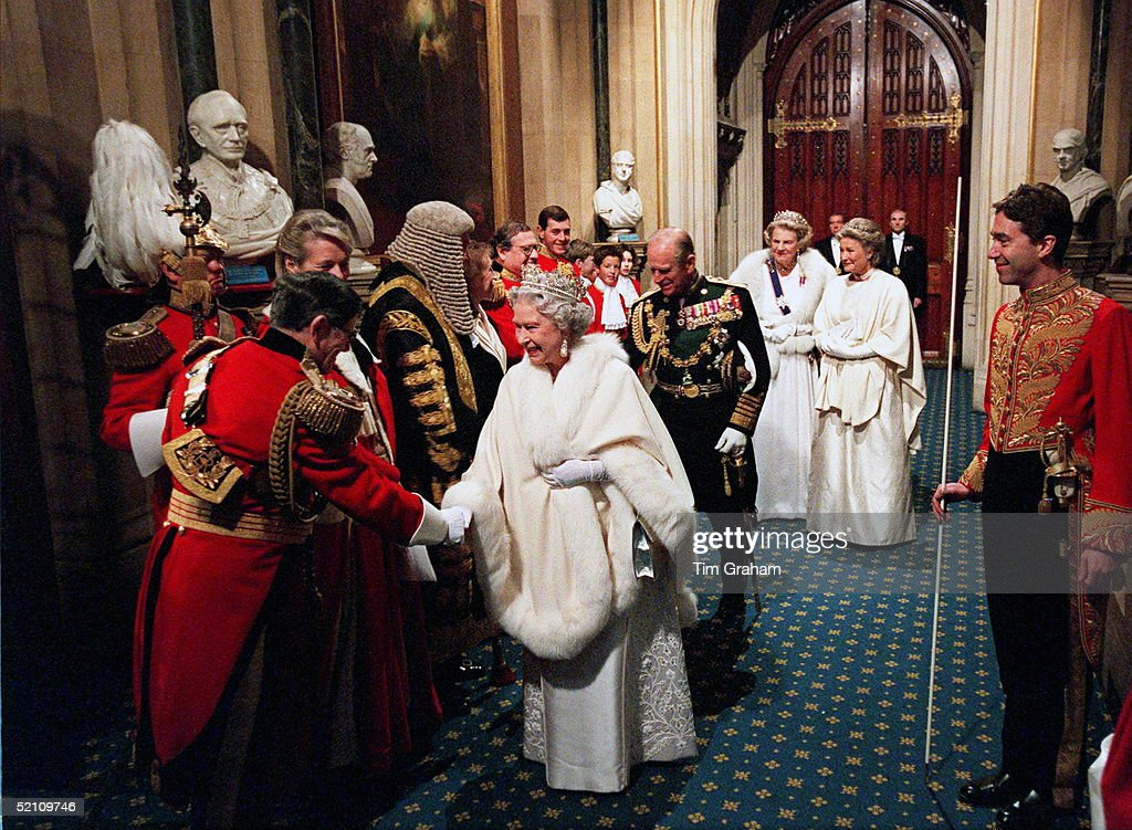 State Opening Of Parliament The Marquess Of Cholmondeley Watching The Queen Shaking Hands With One Of The Gentlemen At Arms The Queen's...