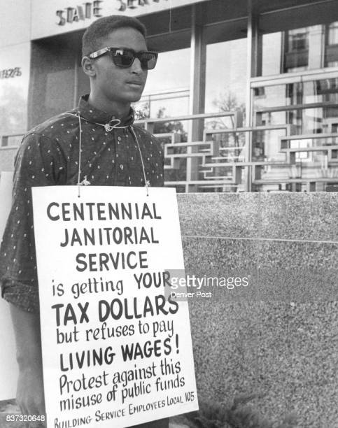 State Picketed Wendell Jones 3725 Eudora St is one of two pickets of the Building Service Employes Local 105 who is marching in front of the State...