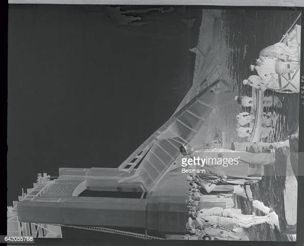 State police and divers in boats search the waters of the Connecticut River for the dead alongside the wreckage of the new $4000 bridge being erected...
