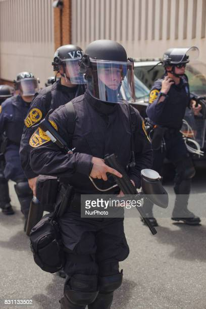 State Police came out heavily armed in a show of force before a news conference held by altright blogger Jason Kessler in front of City Hall August...