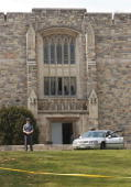 A state police officer continues to stand guard outside Norris hall on the campus of Virginia Tech student where most of the people in Monday's...