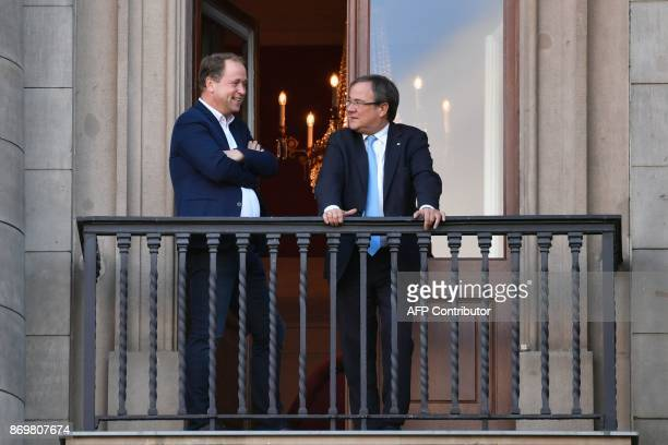 State Premier for the state of North RhineWestphalia CDUs Armin Laschet and Joachim Stamp of the FDP take a break on the balcony outside a meeting...
