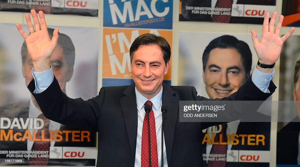 State premier of Lower Saxony David McAllister, waves to supporters at the CDU elections HQ at the Landtag regional parliament in Hanover on January 20, 2013 on polling day of the local elections in the central German state of Lower Saxony. The vote is largely seen as a test run for Chancellor Angela Merkel, her rivals and would-be heirs, eight months before nationwide polls. German Chancellor Angela Merkel's party was ahead after the first state poll in a general election year, exit polls indicated, but it was unclear whether its coalition would cling to power. AFP PHOTO / ODD ANDERSEN